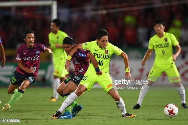 Ryota Moriwaki of Urawa Red Diamonds and Yusuke Tanaka of Ventforet Kofu compete for the ball during the JLeague J1 match between Ventforet Kofu and...