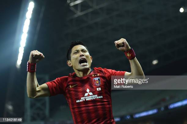 Ryota Moriwaki of Urawa Red Diamonds celebrates a goal by Tomoaki Makino during the AFC Champions League Group G match between Urawa Red Diamonds and...