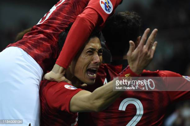 Ryota Moriwaki of Urawa Red Diamonds celebrates with team mates after a goal by Tomoaki Makino during the AFC Champions League Group G match between...