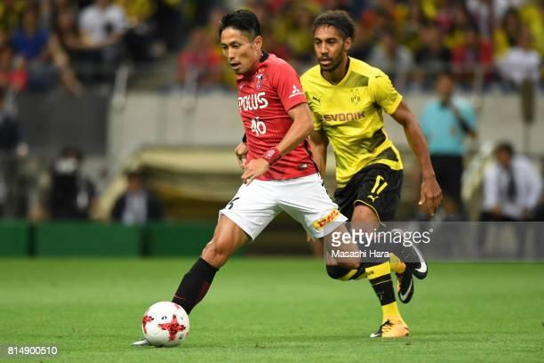 Ryota Moriwaki of Urawa Red Diamonds in action during the preseason friendly match between Urawa Red Diamonds and Borussia Dortmund at Saitama...