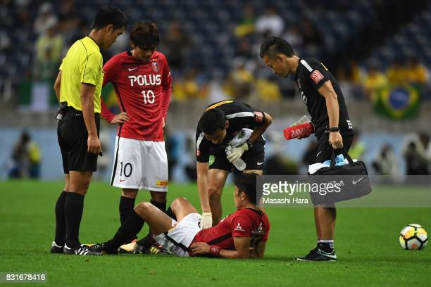 Ryota Moriwaki of Urawa Red Diamonds looks injured during the Suruga Bank Championship match between Urawa Red Diamonds and Chapecoense at Saitama...