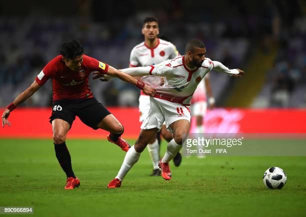 Ryota Moriwaki of Urawa Reds and Ismail El Haddad of Wydad Casablanca battle for the ball during the FIFA Club World Cup UAE 2017 match between Wydad...
