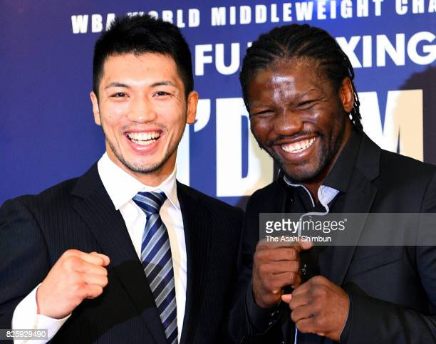 Ryota Murata and Hassan N'Dam pose for photographs during a press conference announcing the rematch of the WBA Middleweight title bout on August 3...