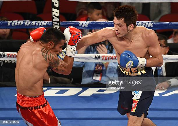 Ryota Murata hits Gunnar Jackson in the fifth round of their middleweight fight at the Thomas Mack Center on November 7 2015 in Las Vegas Nevada