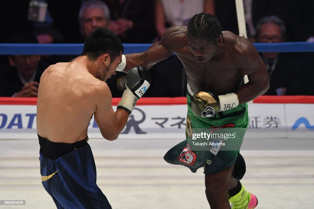 Ryota Murata of Japan (L) and Hassan N'Dam N'Jikam of France (R) exchange punches during during their WBA Middleweight Title Bout at Ryogoku Kokugikan on October 22, 2017 in Tokyo, Japan.