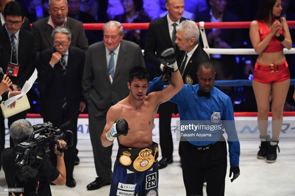 Ryota Murata of Japan (C) celebrates his victory against Hassan N'Dam N'Jikam of France during their WBA Middleweight Title Bout on October 22, 2017 in Tokyo, Japan.
