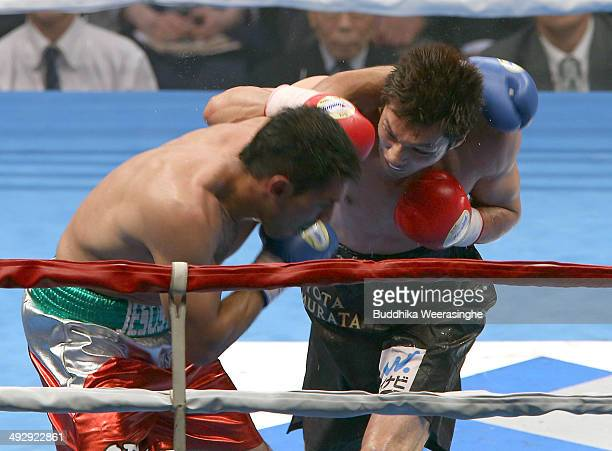 Ryota Murata of Japan exchanges punches with Jesus Angel Nerio of Mexico during their nontitle bout at Shimazu Arena on May 22 2014 in Kyoto Japan...