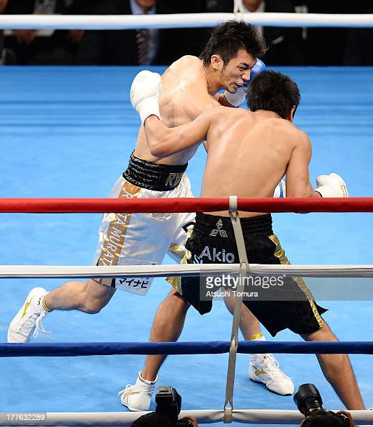 Ryota Murata of Japan punches to knock down Akio Shibata of Japan during his debut match as professional boxer against Akio Shibata at Ariake...