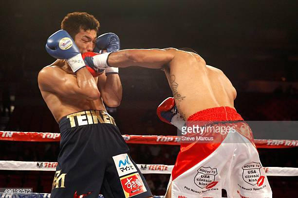 Ryota Murata takes a punch from Gunnar Jackson during their middleweight fight at the Thomas Mack Center on November 7 2015 in Las Vegas Nevada