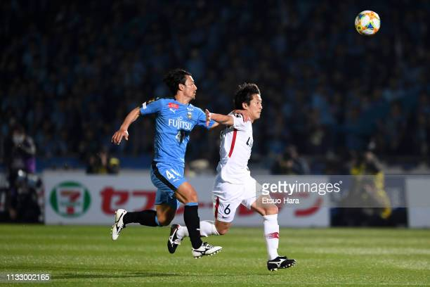 Ryota Nagaki of Kashima Antlers and Akihiro Ienaga of Kawasaki Frontale compete for the ball during the JLeague J1 match between Kawasaki Frontale...