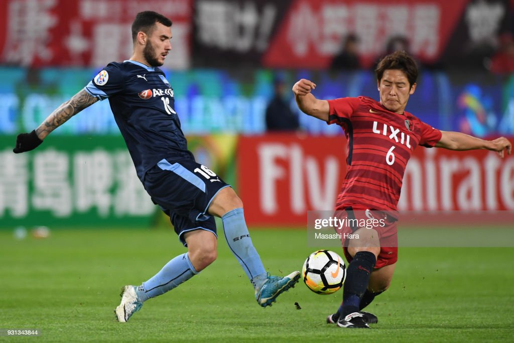 Ryota Nagaki of Kashima Antlers and Kalik Anthony of Sydney FC compete for the ball during the AFC Champions League Group H match between Kashima Antlers and Sydney FC at Kashima Soccer Stadium on March 13, 2018 in Kashima, Ibaraki, Japan.