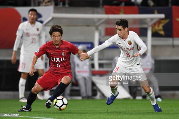 Ryota Nagaki of Kashima Antlers and Oscar of Shanghai SIPG compete for the ball during the AFC Champions League Round of 16 first leg match between...