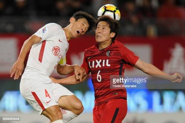 Ryota Nagaki of Kashima Antlers and Wang Shenchao of Shanghai SIPG compete for the ball during the AFC Champions League Round of 16 first leg match...
