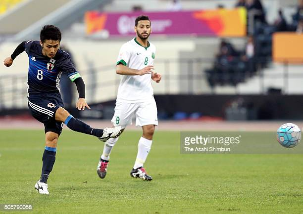 Ryota Ohshima of Japan scors his team's first goal during the AFC U23 Championship Group B match between Saudi Arabia and Japan at Suhaim Bin Hamad...