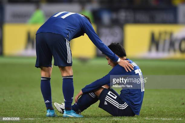 Ryota Oshima of Japan is injured during the EAFF E1 Men's Football Championship between Japan and China at Ajinomoto Stadium on December 12 2017 in...