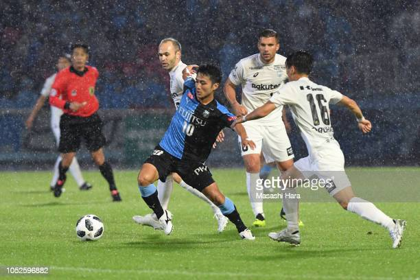 Ryota Oshima of Kawasaki Frontale and Andres Iniesta of Vissel Kobe compete for the ball during the JLeague J1 match between Kawasaki Frontale and...