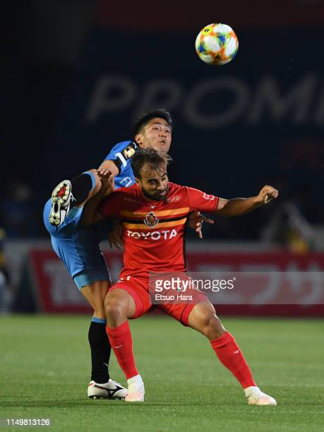 Ryota Oshima of Kawasaki Frontale and Gabrial Xavier of Nagoya Grampus compete for the ball during the JLeague J1 match between Kawasaki Frontale and...