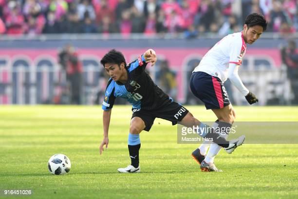 Ryota Oshima of Kawasaki Frontale and Kenyu Sugimoto of Cerezo Osaka compete for the ball during the Xerox Super Cup match between Kawasaki Frontale...