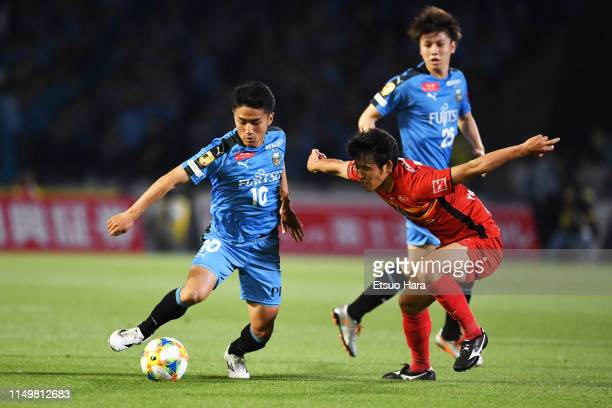 Ryota oshima of Kawasaki Frontale and Takuji Yonemoto of Nagoya Grampus compete for the ball during the JLeague J1 match between Kawasaki Frontale...