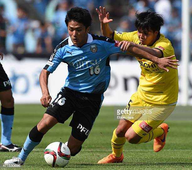 Ryota Oshima of Kawasaki Frontale and Yusuke Kobayashi of Kashiwa Reysol compete for the ball during the JLeague match between Kawasaki Frontale and...