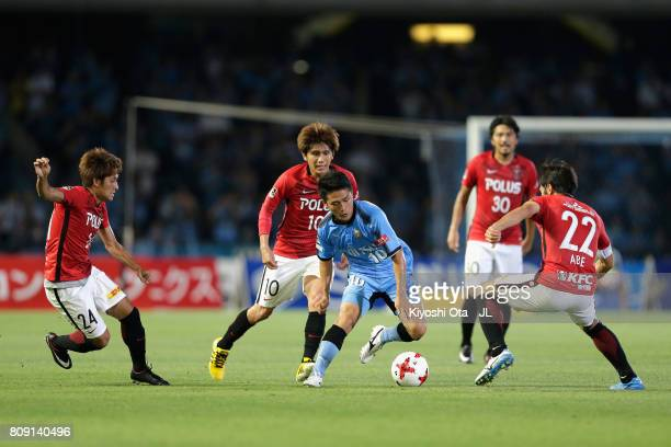 Ryota Oshima of Kawasaki Frontale controls the ball under pressure of Urawa Red Diamonds defense during the JLeague J1 match between Kawasaki...