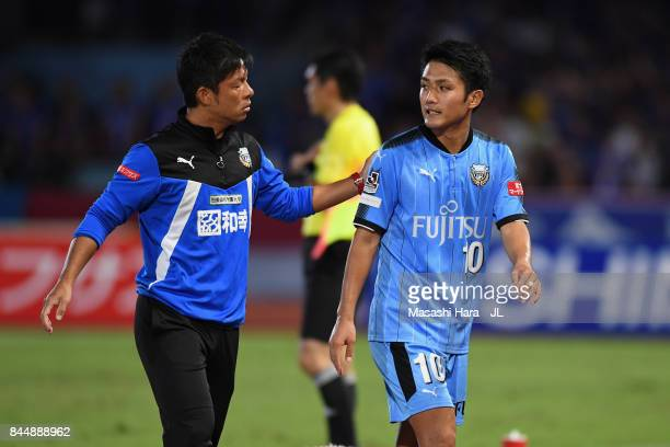 Ryota Oshima of Kawasaki Frontale talks with head coach Toru Oniki after substituted during the JLeague J1 match between Kawasaki Frontale and...