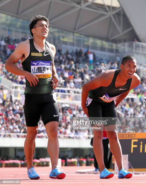 Ryota Yamagata and Aska Cambridge prepare for competing in the Men's 100m during the 52nd Oda Memorial Meet at Edion Stadium Hiroshima on April 29...
