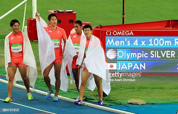Ryota Yamagata Aska Cambridge Yoshihide Kiryu and Shota Iizuka of Japan celebrate winning the silver medal in the Men's 4x100m Relay final on day 14...