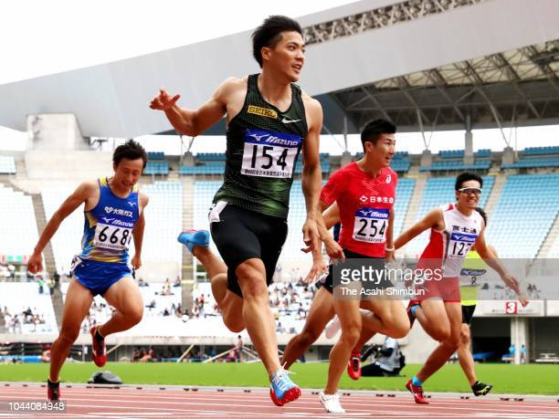 Ryota Yamagata crosses the finish line to win the Men's 100m Final on day three of the Japan Industrial Track Field Championships at the Yanmar...