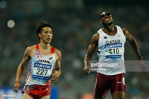 Ryota Yamagata of Japan and Samuel Adelebari Francis of Qatar compete in Men's 100m Semifinal during day nine of the 2014 Asian Games at Incheon...