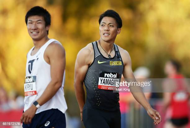 Ryota Yamagata of Japan and Yoshihide Kiryu of Japan look on after competing in the Men's 100m A Final during the SUMMERofATHS Grand Prix on March 11...