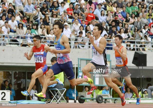 Ryota Yamagata runs on his way to finishing first in the men's 100meter final in 1000 seconds at the national corporate athletics championships at...
