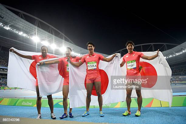 Ryota Yamagata Shota Iizuka Yoshihide Kiryu and Aska Cambridge of Japan celebrates after winning silver in the Men's 4 x 100m Relay Final on Day 14...