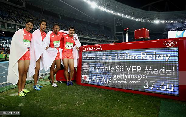 Ryota Yamagata Shota Iizuka Yoshihide Kiryu and Aska Cambridge of Japan celebrate after winning silver in the Men's 4 x 100m Relay Final on Day 14 of...