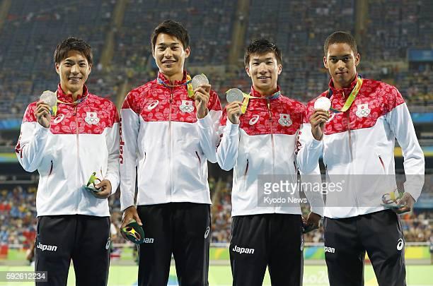 Ryota Yamagata Shota Iizuka Yoshihide Kiryu and Asuka Cambridge of Japan pose with their silver medals during the award ceremony for the men's...