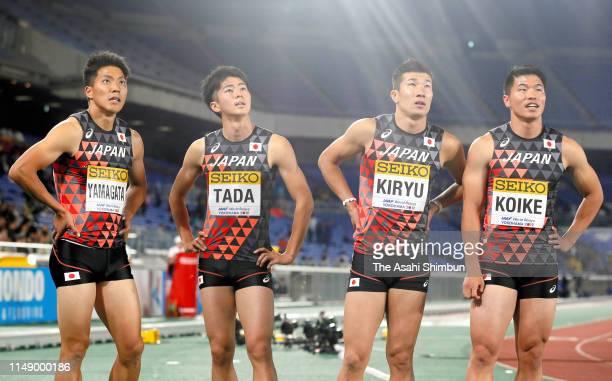 Ryota Yamagata Shuhei Tada Yoshihide Kiryu and Yuki Koike of Japan react after disqualification in the Men's 4x100m Relay on day one of the IAAF...