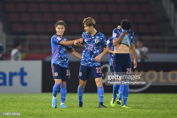 Ryotaro Meshino of Japan celebrates scoring his sides goal with his teammate during the AFC U-23 Championship match between Japan and Saudi Arabia at...