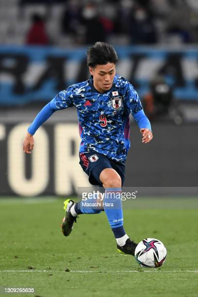 Ryotaro Meshino of Japan in action during the U-24 international friendly match between Japan and Argentina at the Tokyo Stadium on March 26, 2021 in...