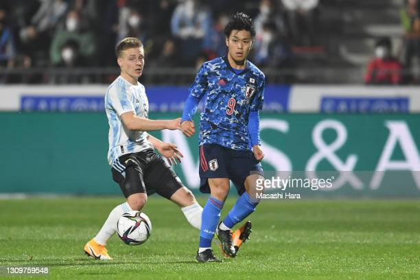 Ryotaro Meshino of Japan in action during the U-24 international friendly match between Japan and Argentina at the Kitakyushu Stadium on March 29,...