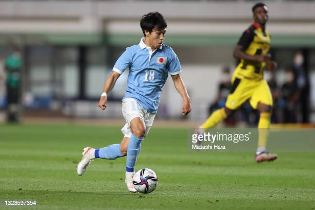 Ryotaro Meshino of Japan in action during the U-24 international friendly match between Japan and Ghana at the Best Denki Stadium on June 05, 2021 in...