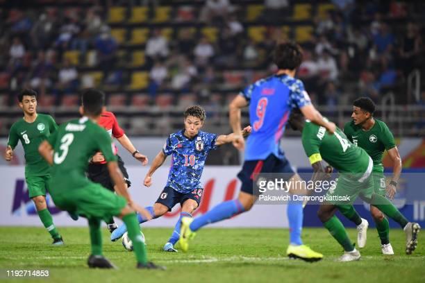 Ryotaro Meshino of Japan shoots the ball during the AFC U-23 Championship match between Japan and Saudi Arabia at Thammasat Stadium on January 9,...