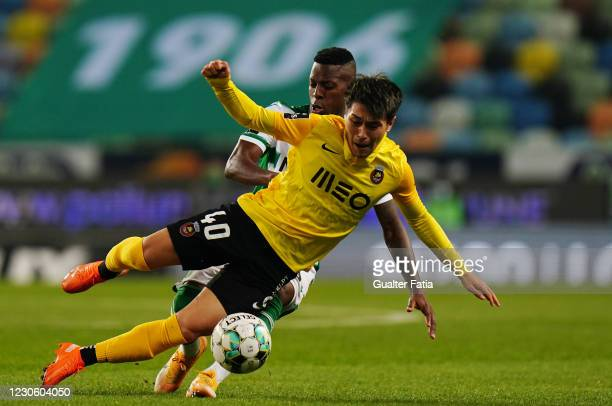 Ryotaro Meshino of Rio Ave FC with Cristian Borja of Sporting CP in action during the Liga NOS match between Sporting CP and Rio Ave FC at Estadio...