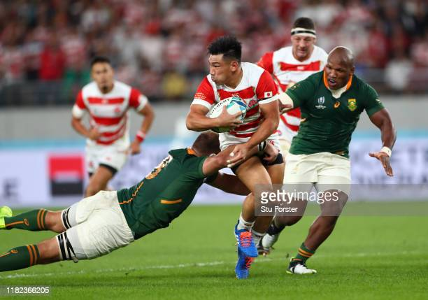 Ryoto Nakamura of Japan is tackled by Duane Vermeulen of South Africa during the Rugby World Cup 2019 Quarter Final match between Japan and South...