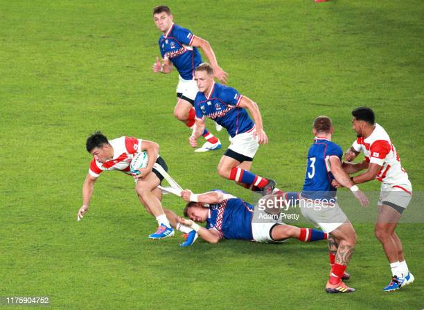 Ryoto Nakamura of Japan is tackled during the Rugby World Cup 2019 Group A game between Japan and Russia at the Tokyo Stadium on September 20 2019 in...