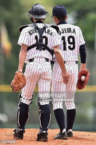 Ryoya Kurihara and Kazuya Ojima of Japan during the Asian 18U Baseball Championship semi-final game between Japan and Chinese Taipei at Baseball...