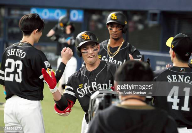 Ryoya Kurihara of the Fukuoka SoftBank Hawks celebrates with his team mates after hitting a two-run home run to make it 0-2 in the 2nd inning during...