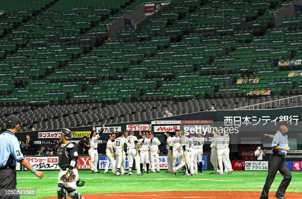 Ryoya Kurihara of the Fukuoka SoftBank Hawks is congratulated by his team mates after hitting a walk-off single in the 10th inning during the game...