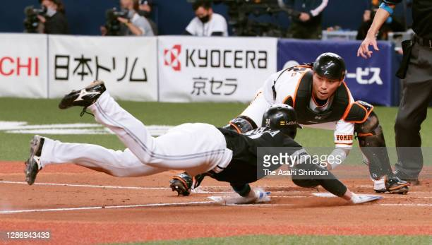 Ryoya Kurihara of the Fukuoka SoftBank Hawks is tagged out by Takumi Oshiro of the Yomiuri Giants in the 4th inning during the game one of the Japan...