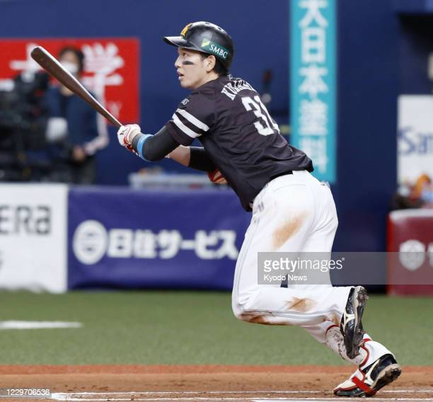 Ryoya Kurihara of the SoftBank Hawks hits a two-run double in the sixth inning in Game 1 of the Japan Series against the Yomiuri Giants at Kyocera...