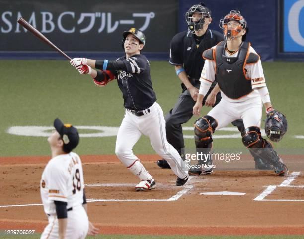 Ryoya Kurihara of the SoftBank Hawks hits a two-run home run in the second inning off Yomiuri Giants ace Tomoyuki Sugano in Game 1 of the Japan...